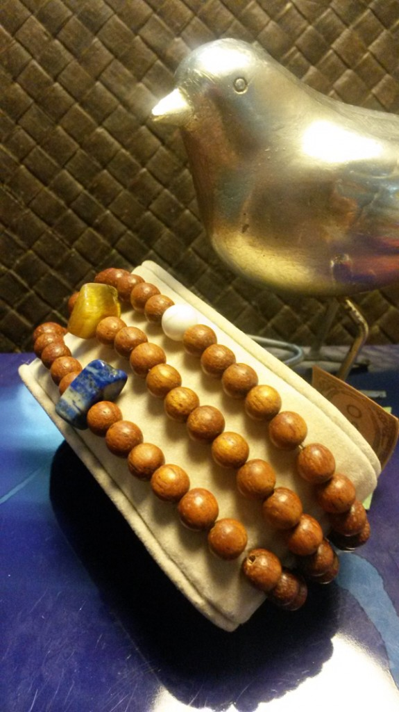 These wooden beads are charming.  Come this weekend and see them up close!