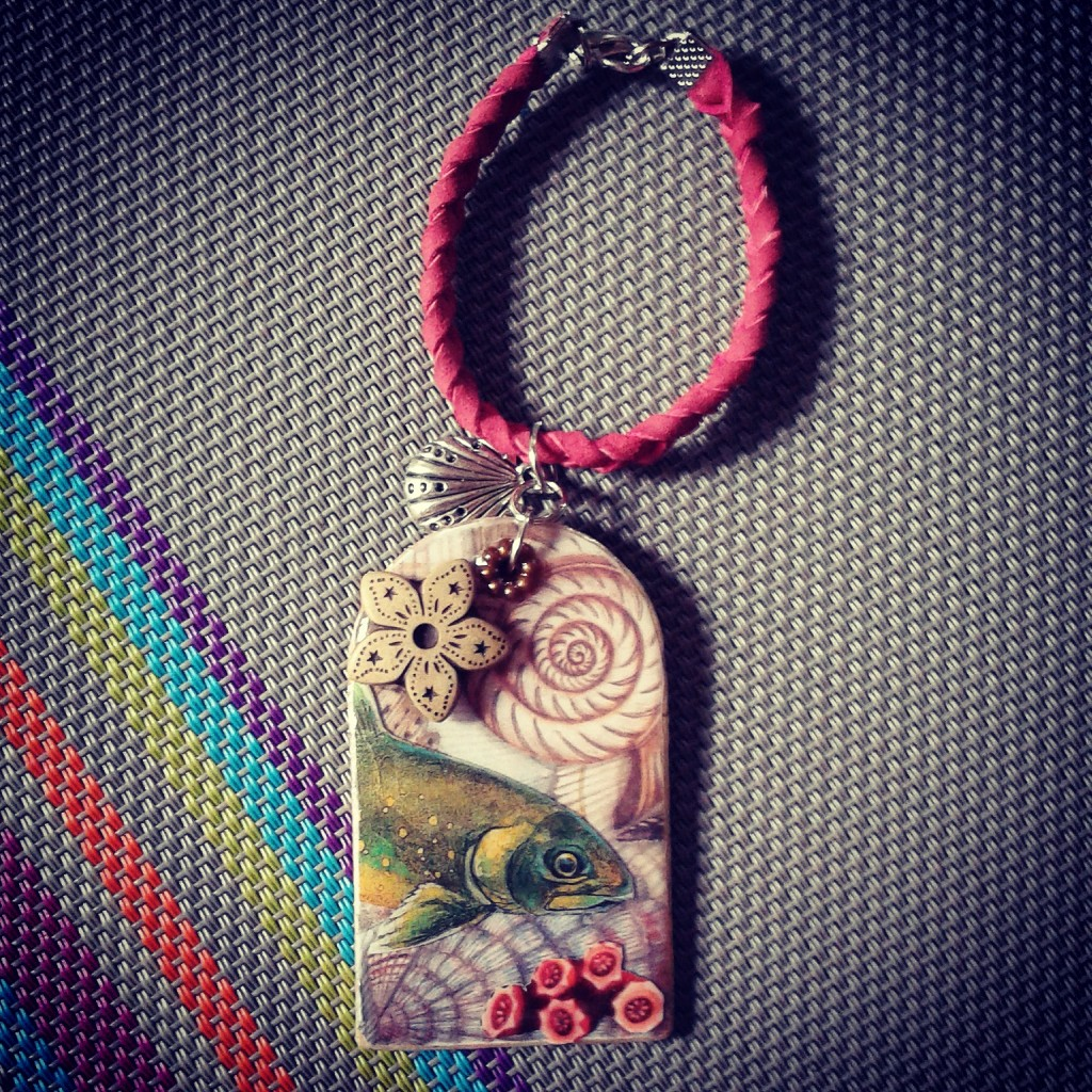 One of Handmade Lemonade's resin-covered collage trinkets.  Marita truly has her own style of vintage-eclectic collages.